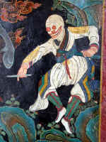 A skeleton with a magic wand dances at Nechung Monastery.JPG (63794 bytes)